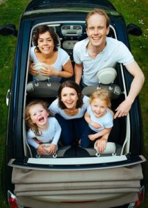 happy family laughing in the car