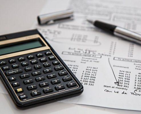 Calculator, receipt, and pen on a desk