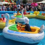 kids playing in big floaties in a pool