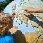 kid looking at a globe