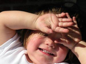 kid shielding his eyes